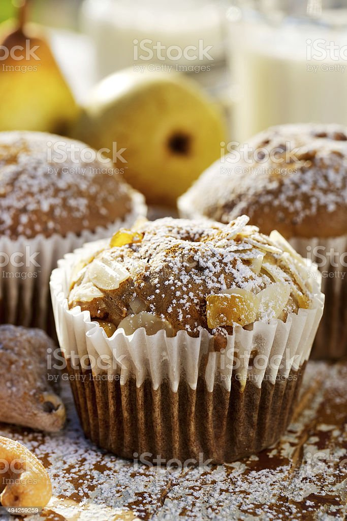 Pear, almond and cinnamon muffins stock photo