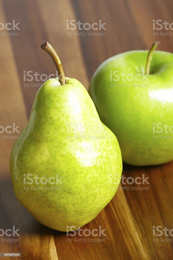 Pear and apple on table royalty-free stock photo