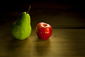 apple and ripe pear, rustic wooden table
