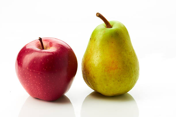 Pear and red apple on white stock photo