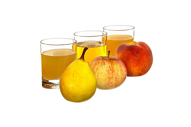 Pear, apple and peach in the background glasses with juice