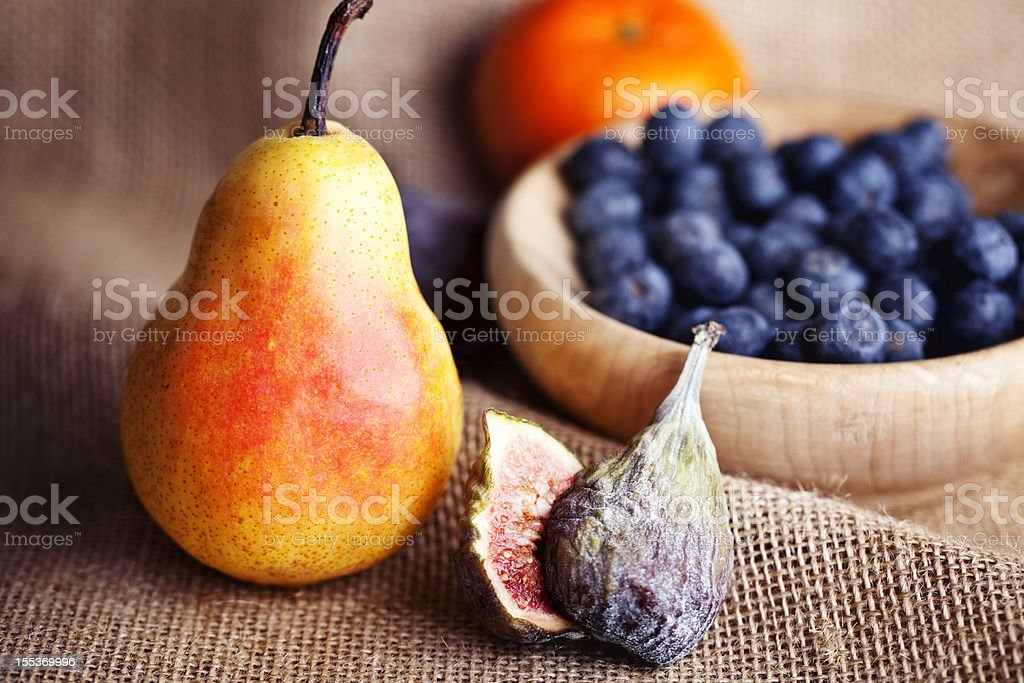pear, fig and a bowl with blue berries royalty-free stock photo