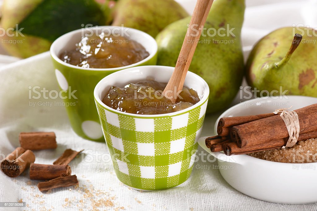 pear jam in the green jar stock photo
