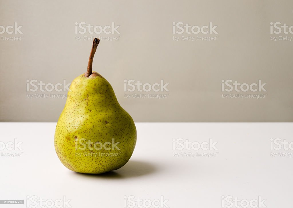 Pear on white table stock photo