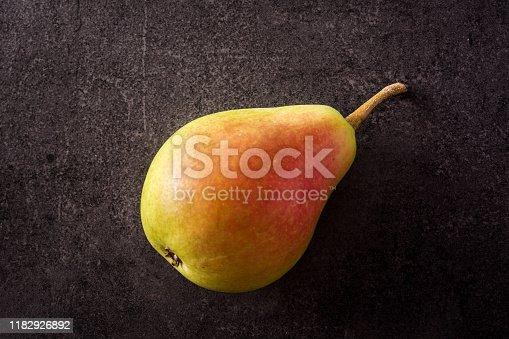 Pear on black slate background