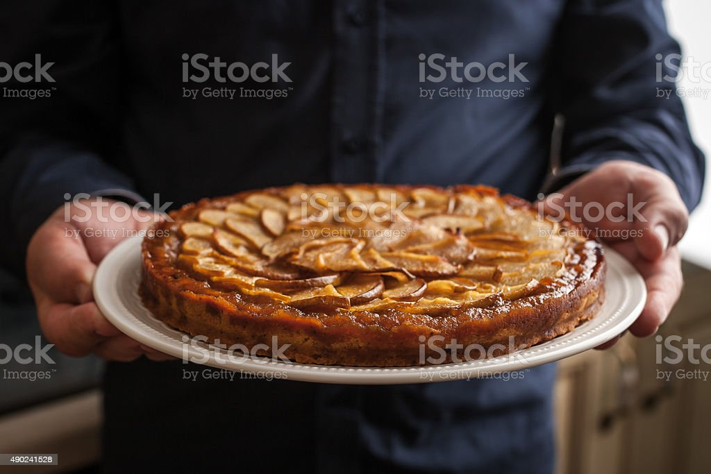 Pear tart in the man hands horizontal stock photo