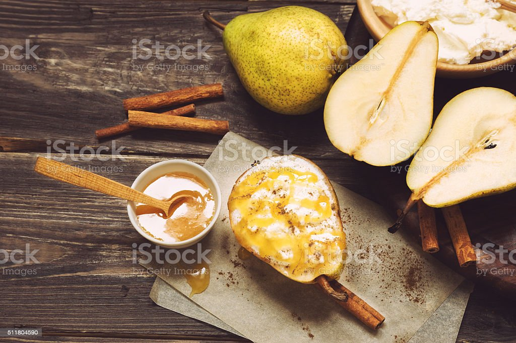 Pear with ricotta cheese, honey and cinnamon stock photo
