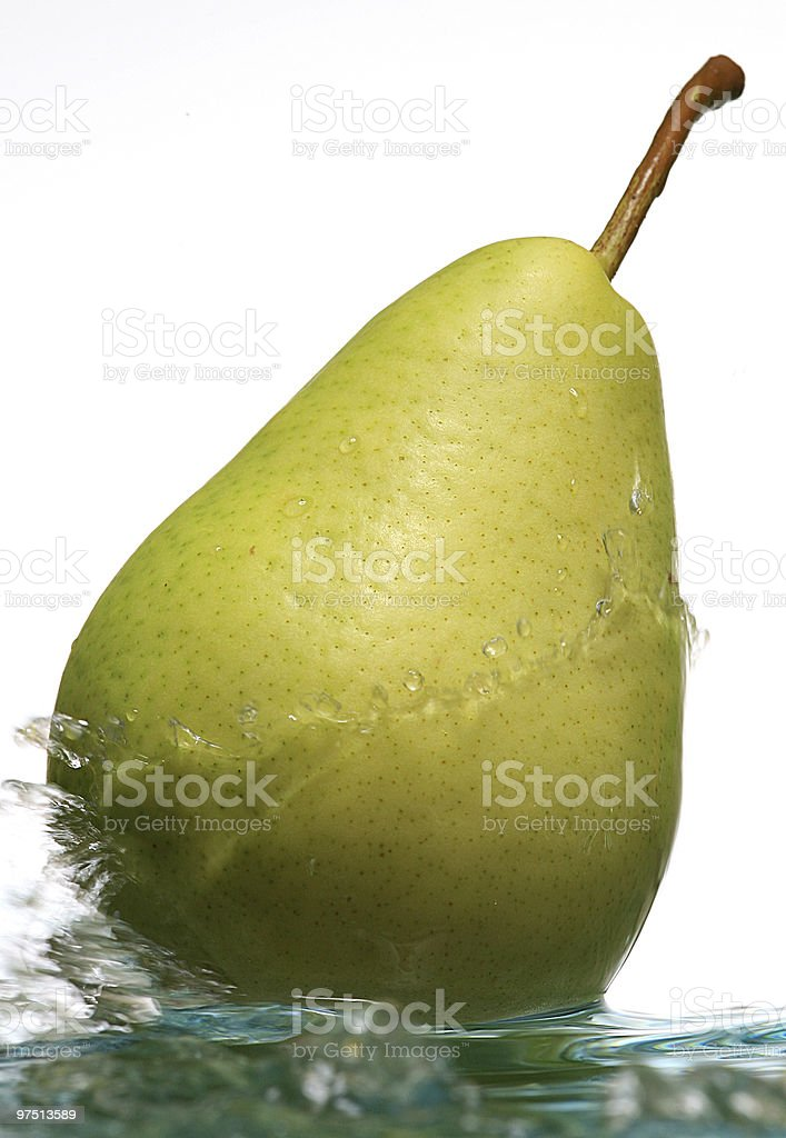 pear with water flow on white background royalty-free stock photo