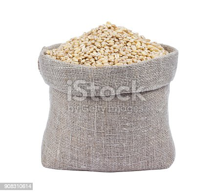 istock Pearl barley in bag isolated on white background 908310614