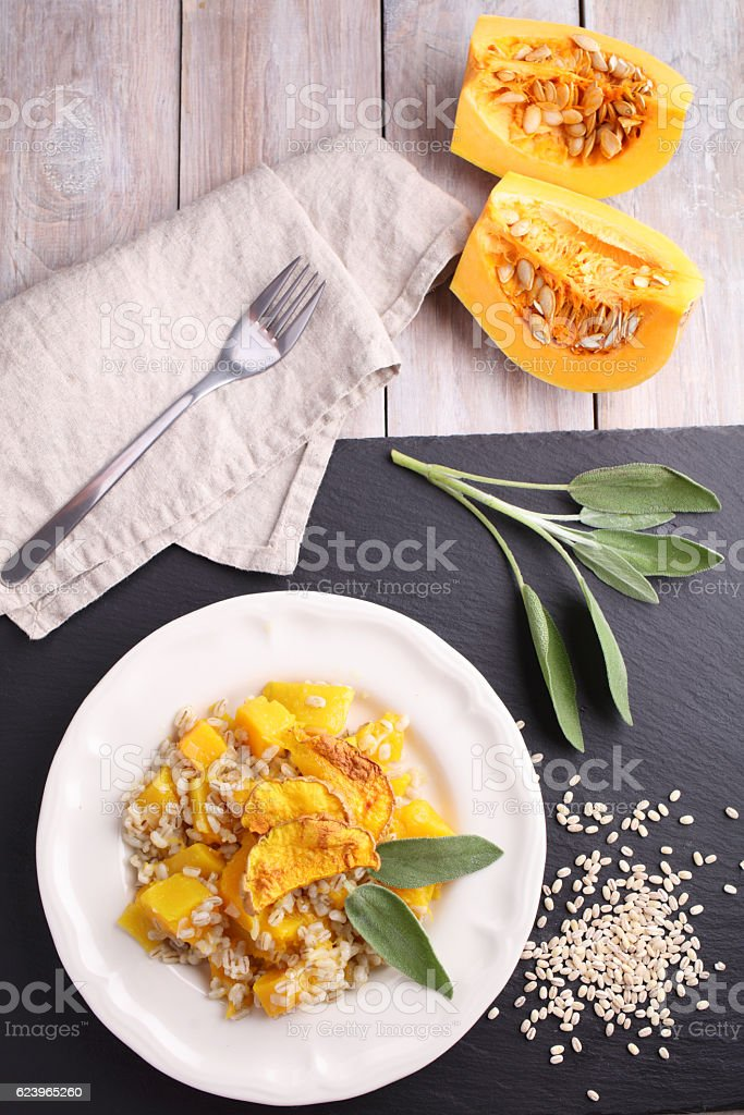 Pearl barley risotto with pumpkin and sage stock photo