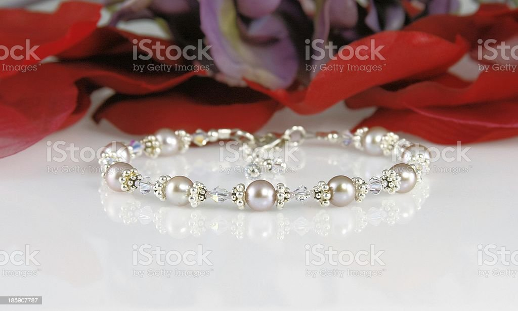 Pearl Bracelet and Flower Petals stock photo