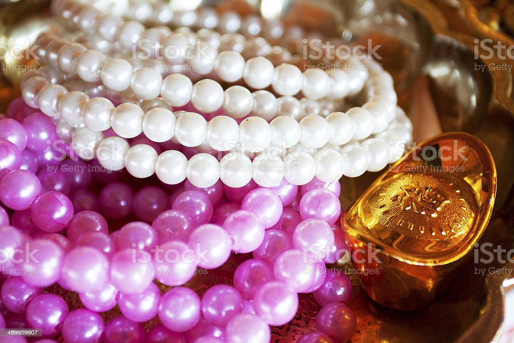Pearl chains and golden amulett royalty-free stock photo
