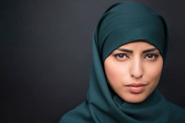 Pearl From The East Portrait of a beautiful muslim woman wearing hijab. headscarf stock pictures, royalty-free photos & images
