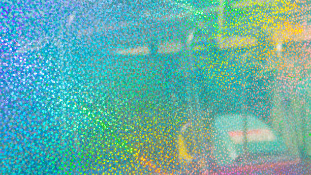 pearl iridescent sparkle glitter wall covering, encrusted with shimmering pieces, shining under direct sun light giving a rainbow colour effect. - hologram stock photos and pictures