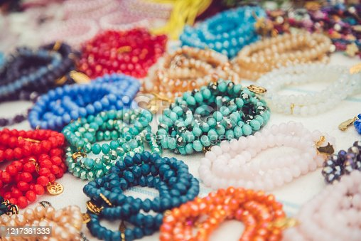 Handmade pearl jewelry and prayer beads on a street market.