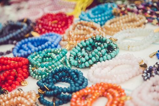 Handmade pearl jewelry and prayer beads on a street market.