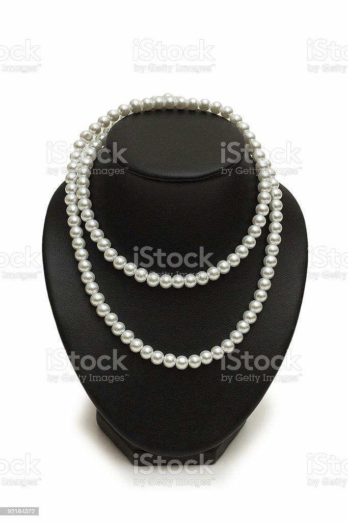 Pearl necklace on the stand isolated royalty-free stock photo