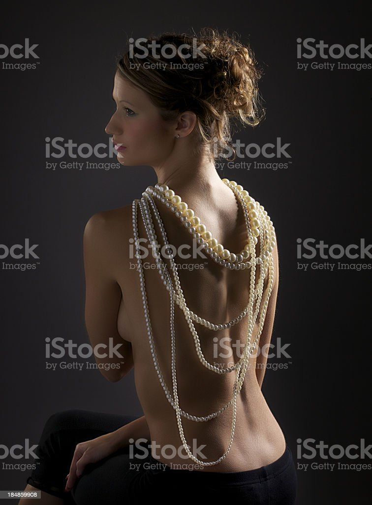 Pearl Necklace on Young Woman's Nude Back royalty-free stock photo
