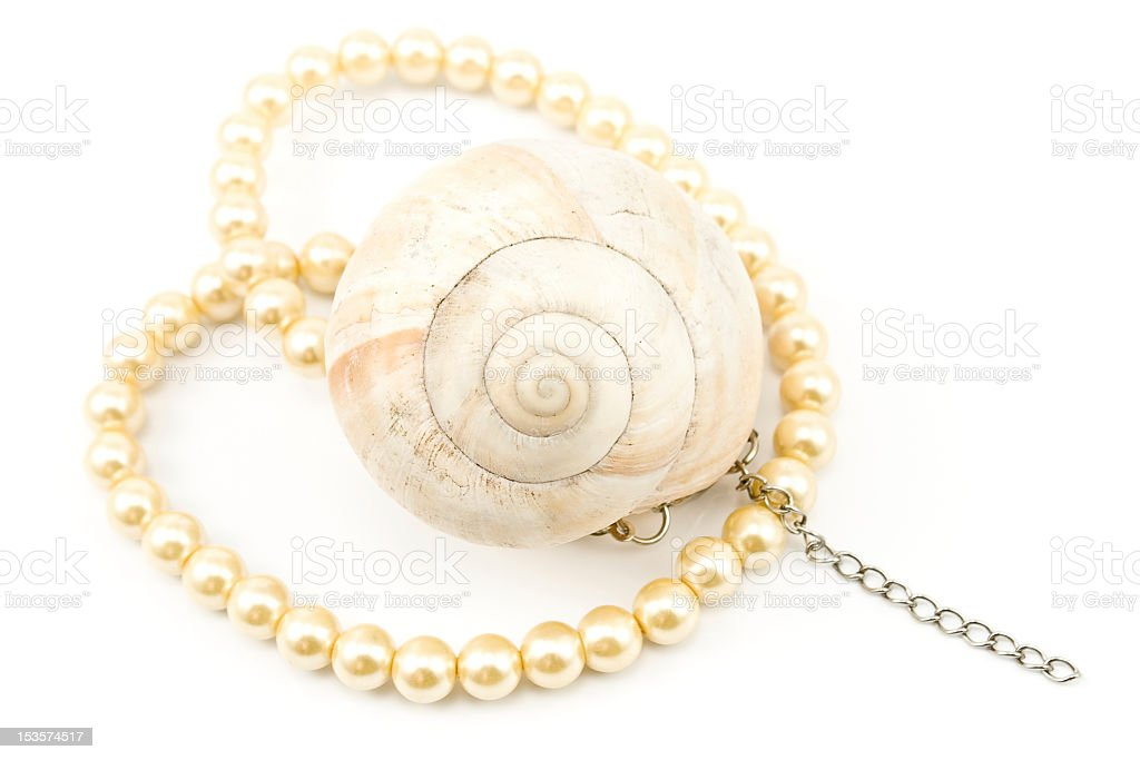 Pearl necklace with spiral seashell royalty-free stock photo