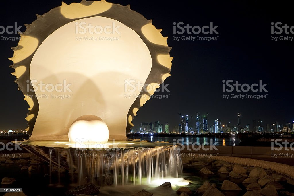 Pearl & Oyster Fountain On Corniche, Doha, Qatar at Night royalty-free stock photo