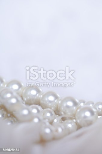 istock Pearls and Feathers, romantic set up with empty space 846525434