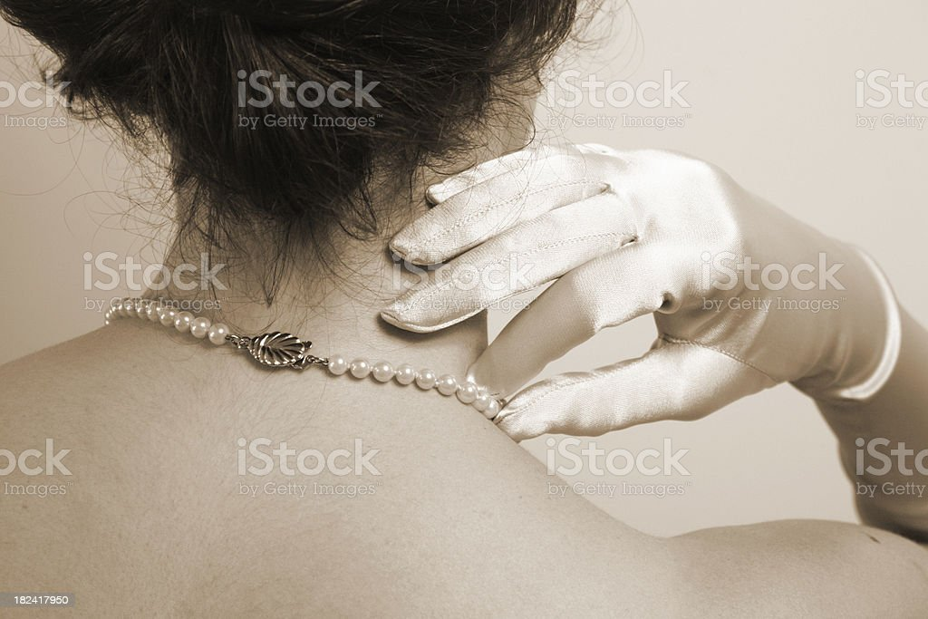 Pearls and gloves stock photo