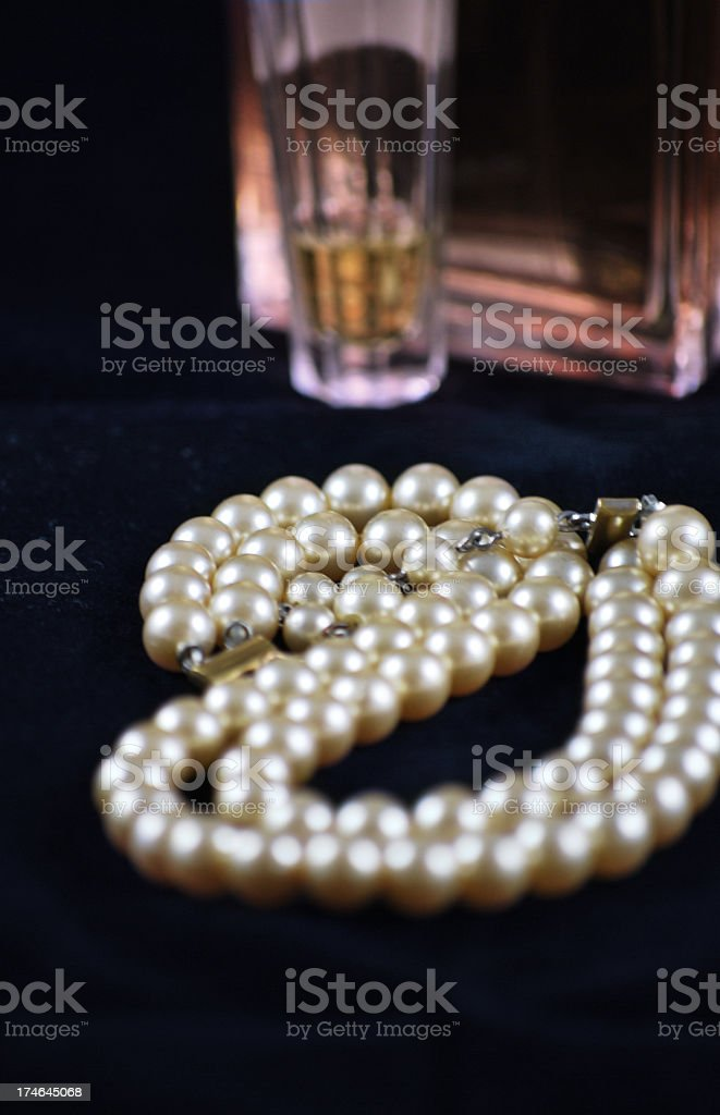 Pearls and perfume royalty-free stock photo