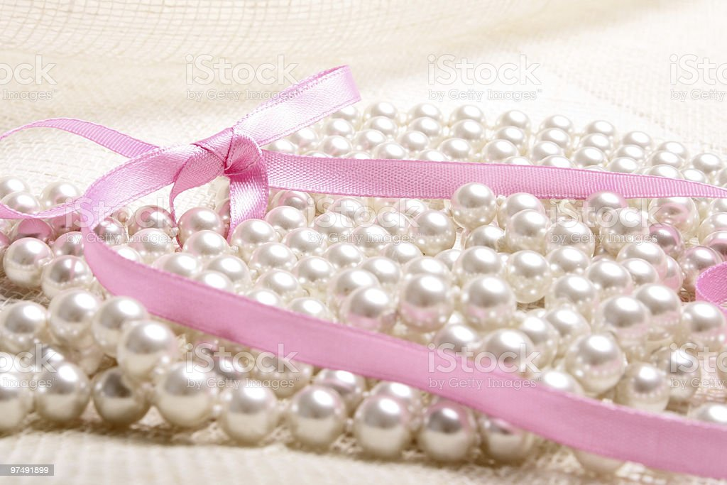Pearls on canvas royalty-free stock photo