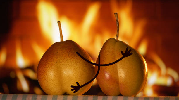 Pears and fireplace - foto stock