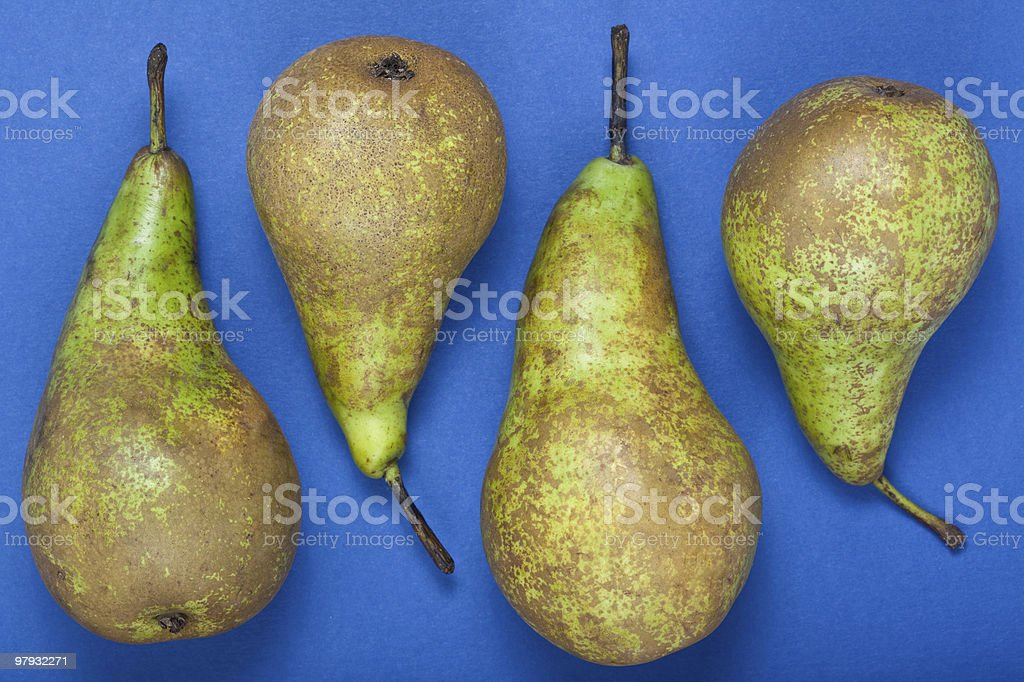 Pears on a blue backgound royalty-free stock photo