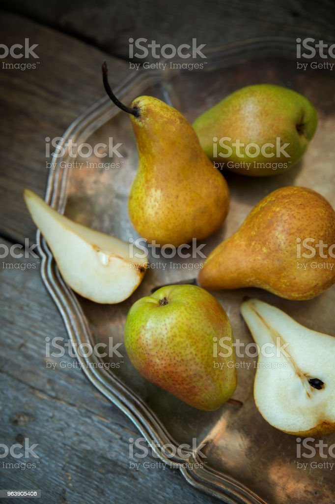 Pears on a tray and an old wooden background. - Royalty-free Agriculture Stock Photo