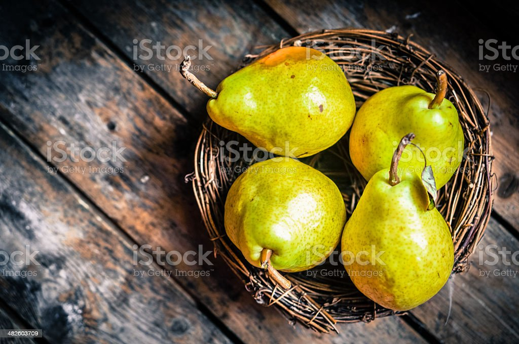Pears on rustic wooden background stock photo