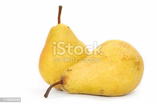 Two ripe yellow pears isolated on white background.
