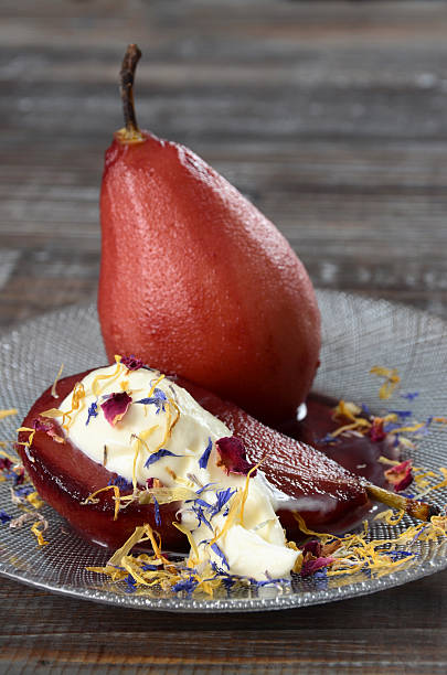 Pears poached in red wine with edible flowers picture id185332008?b=1&k=6&m=185332008&s=612x612&w=0&h=y wtscdlnfjbt9zkfrdcbti39raa9zwomdfgprt8lp8=