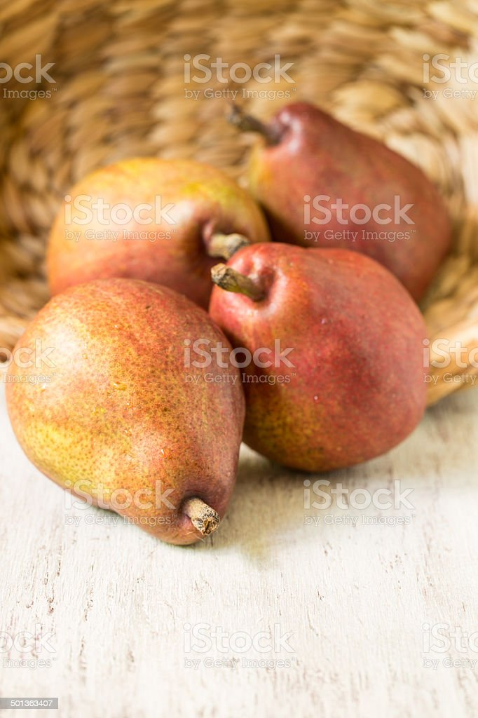 Pears Spilling From Wicker Basket Vertical stock photo