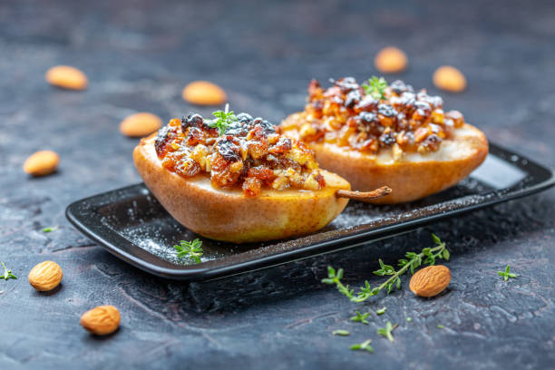 Pears with nuts, raisins and spices. stock photo