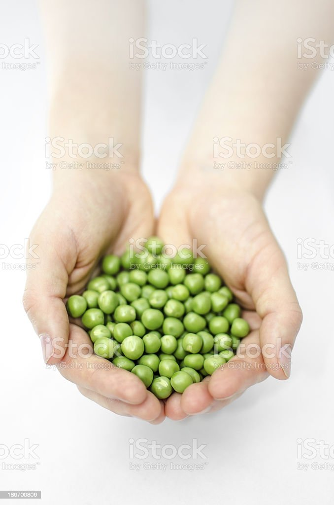 peas in hands royalty-free stock photo