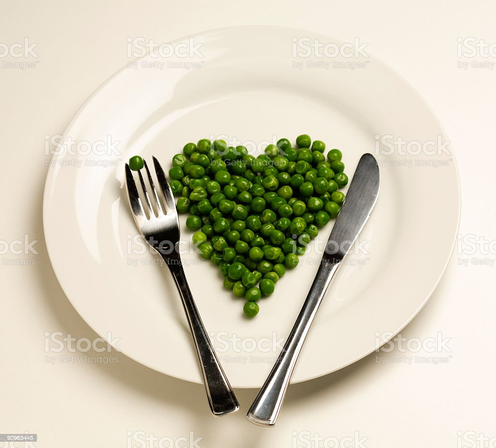 Peas on a plate in heart shape royalty-free stock photo