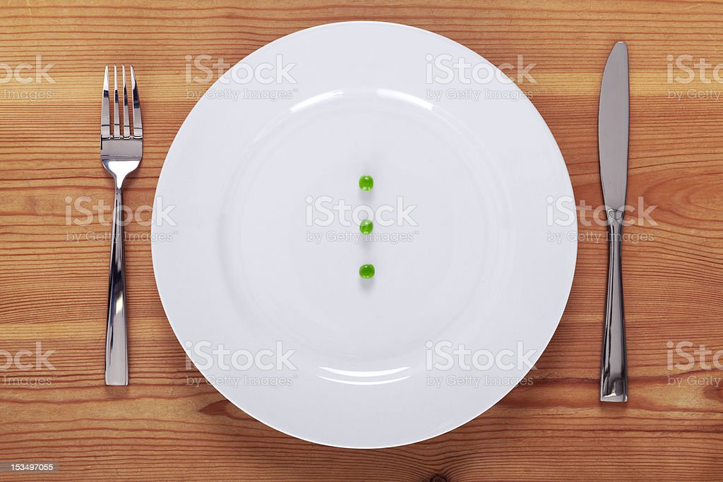 Peas on a white plate royalty-free stock photo