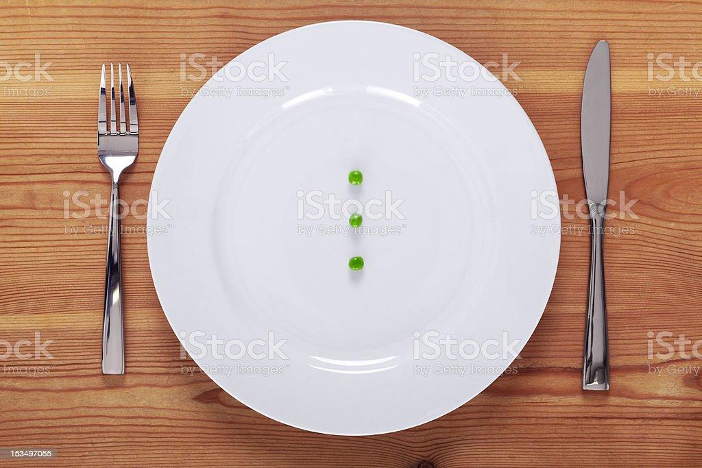 Peas on a white plate stock photo