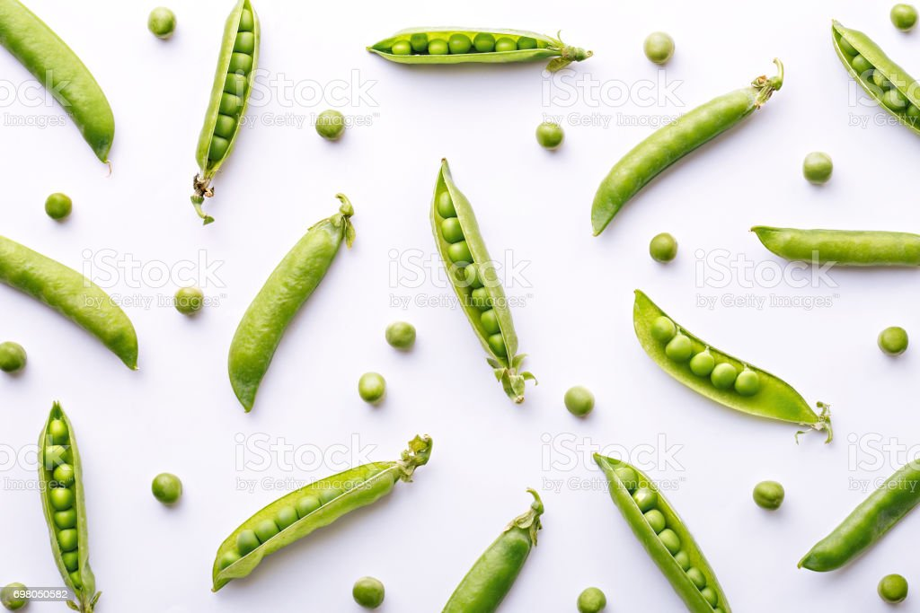 Peas pattern. Top view of fresh vegetable on a white background. Repetition concept stock photo