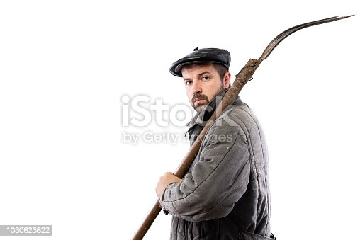 Peasant man with pitchfork on white background, serious concentrated look. Concept - hard life of peasant
