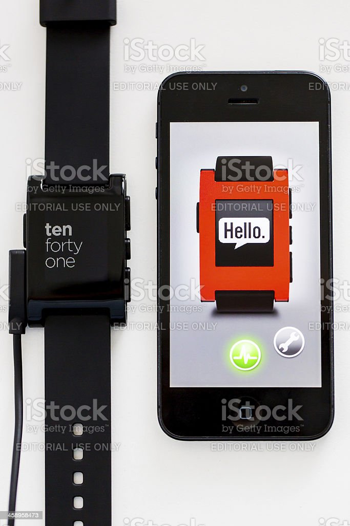 Pebble Smart Watch and Apple iPhone 5 royalty-free stock photo