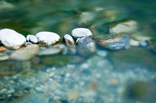 Pebbles and arranged stones in river water. Long exposure at daytime only possible with nd- and circular pol filters mounted.MORE RELATED IMAGES HERE: