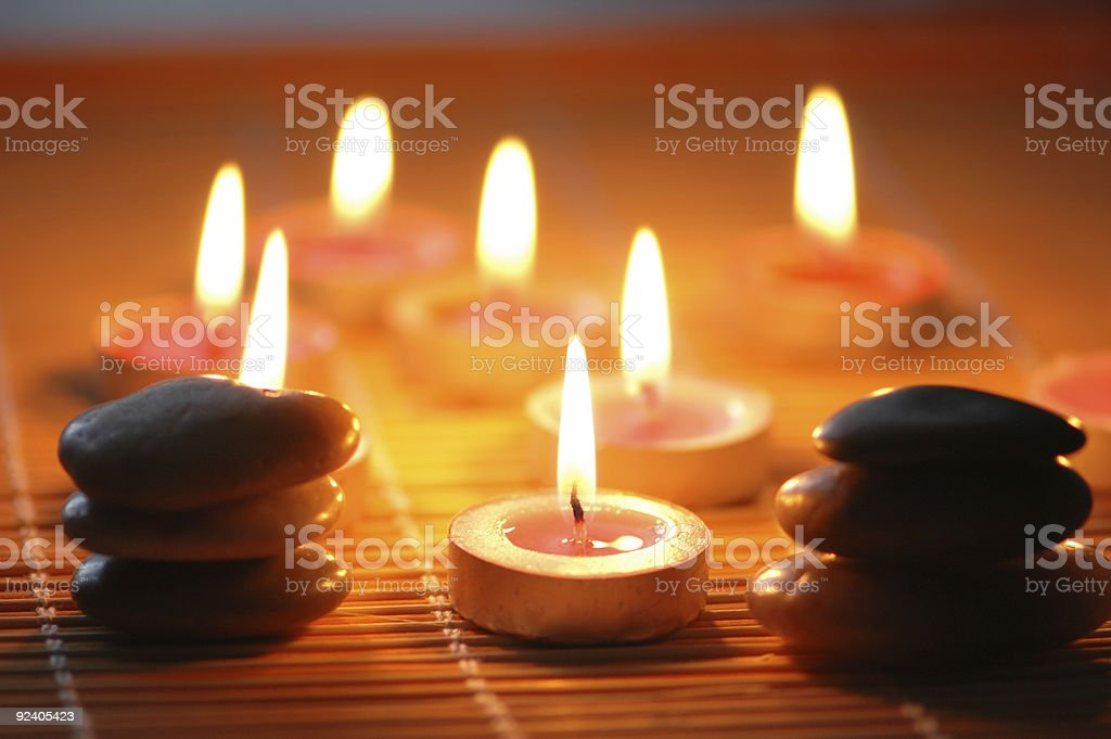 Pebbles and candles for the aromatherapy session royalty-free stock photo