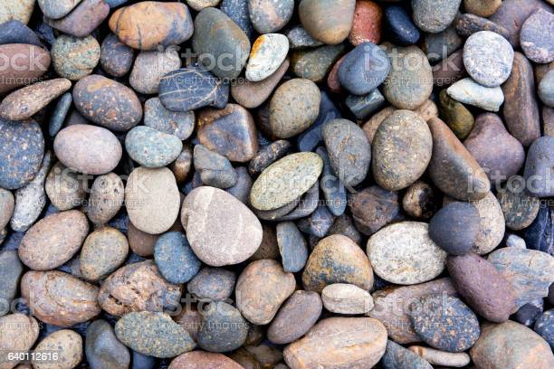 Photo of Pebbles background.Gravel background.Colorful pebbles background