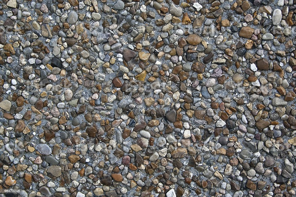 Pebbles in Concrete royalty-free stock photo