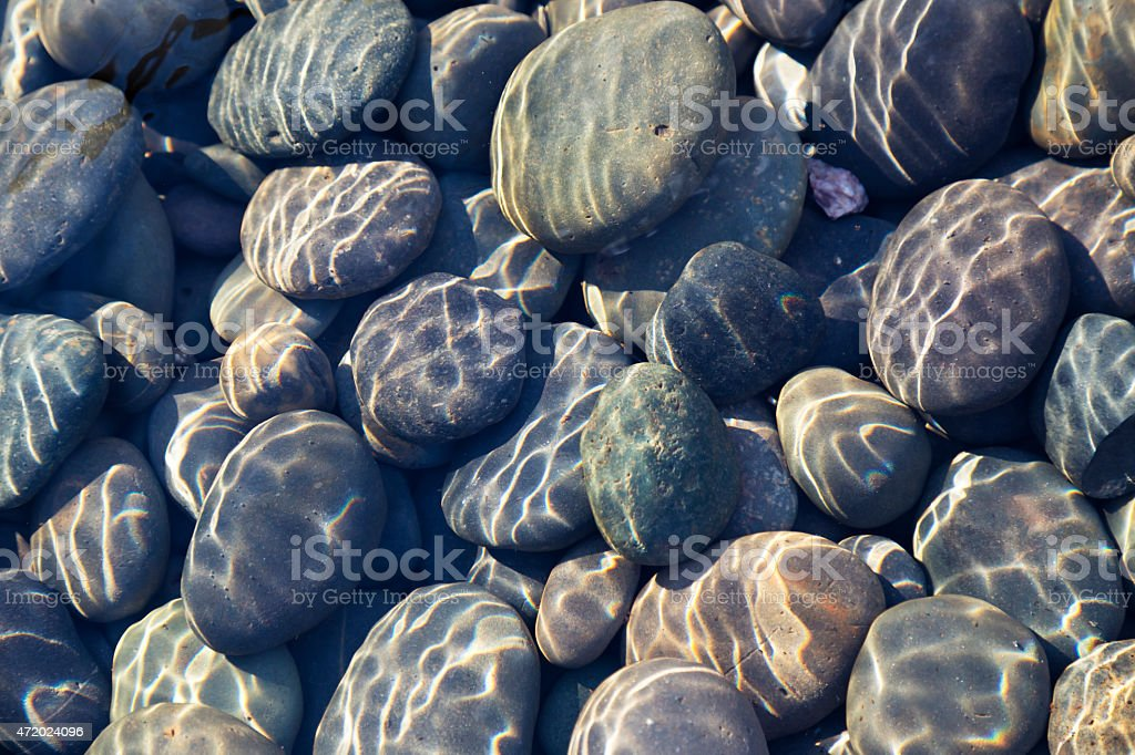 Pebbles in Stream with Ripples Useful for Background or Texture stock photo