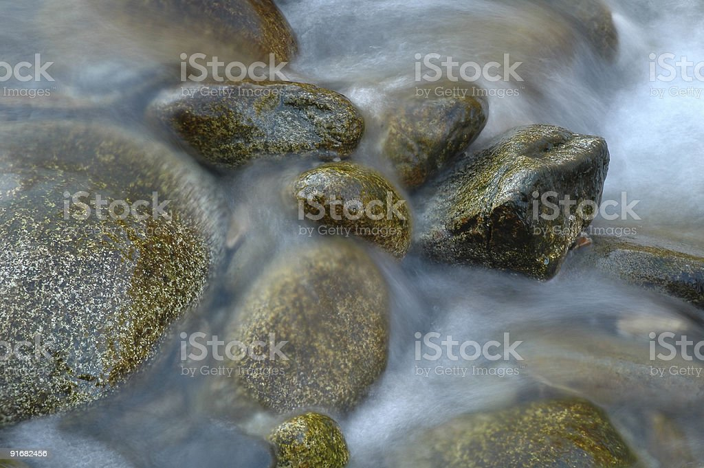 Pebbles in the river stock photo