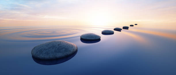 Pebbles in wide calm Ocean Row of stones in calm water in the wide ocean concept of meditation - 3D illustration tranquil scene stock pictures, royalty-free photos & images